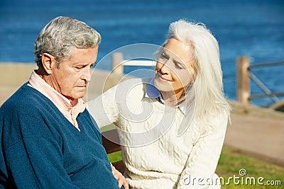 Senior Woman Comforting Depressed Husband