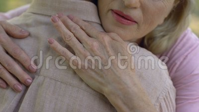 Senior woman condolencing to man about disease or loss, support, care, closeup. Stock footage stock video footage