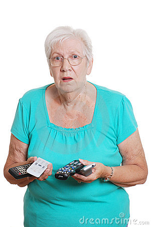 Senior woman confused with lots of tv remotes