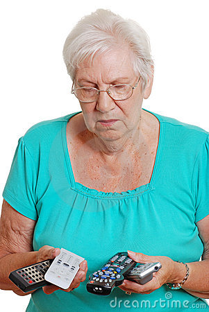 Senior woman confused with so many remote controls