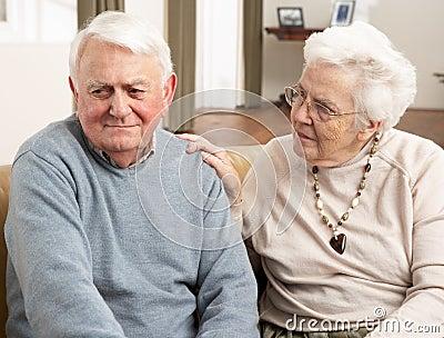 Senior Woman Consoling Husband