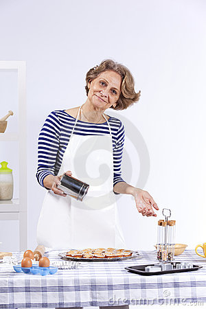 Senior Woman Cooking Royalty Free Stock Photo - Image: 19781325