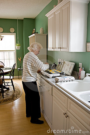 Senior woman cooking breakfast