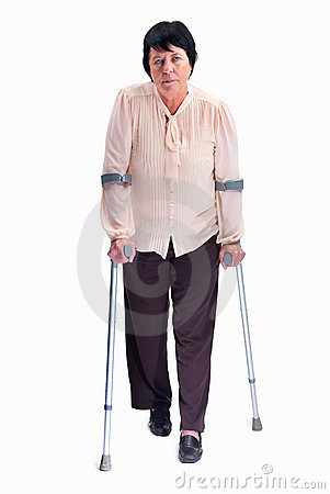 Senior woman with crutches isolated on white