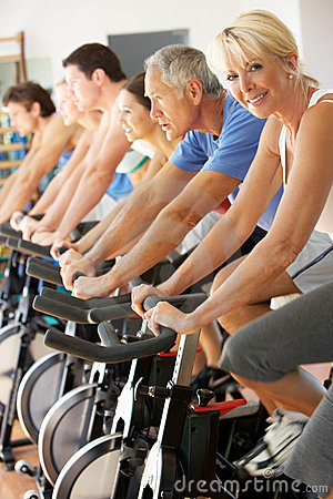 Senior Woman Cycling In Spinning Class