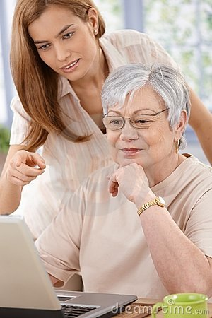 Senior woman and daughter browsing internet