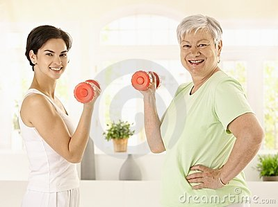 Senior woman doing dumbbell exercise