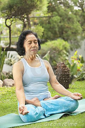 Senior woman doing meditation for yoga