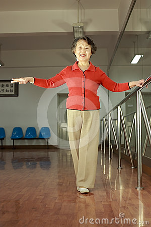 A senior woman doing physical exercise