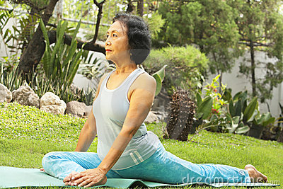 Senior woman doing yoga at park