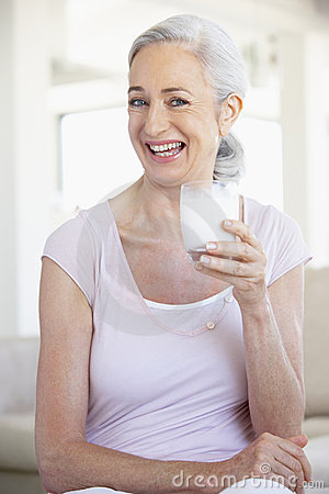 Senior Woman Drinking A Glass Of Milk