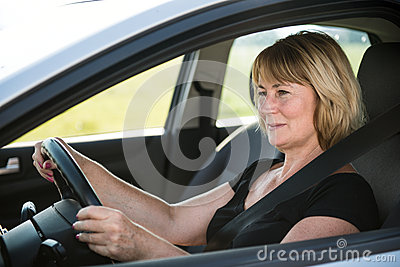 Senior woman driving car