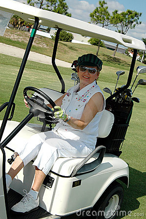 Free Senior Woman Driving Golf Cart Royalty Free Stock Image - 1674446