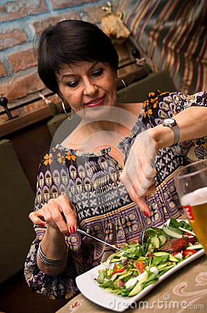 Senior Woman Eating Royalty Free Stock Photo - Image: 25702455