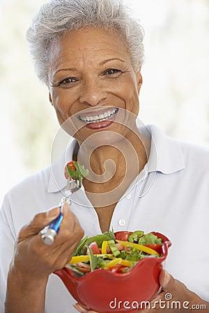 Free Senior Woman Eating A Fresh Green Salad Royalty Free Stock Image - 7875796