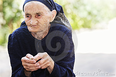 Senior woman eating cherry