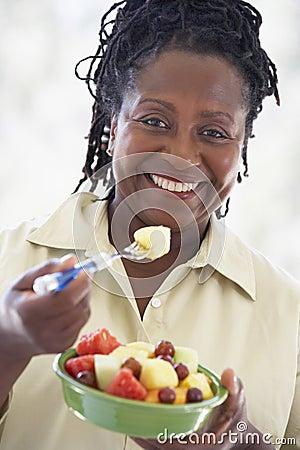 Senior Woman Eating Fresh Fruit Salad