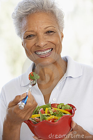 Senior Woman Eating A Fresh Green Salad