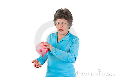 Senior woman with empty piggy bank