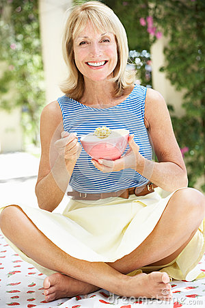 Free Senior Woman Enjoying Bowl Of Breakfast Cereal Royalty Free Stock Photo - 27274065