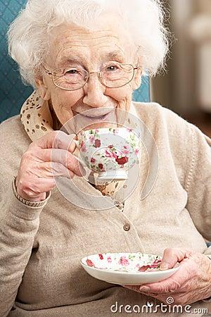 Free Senior Woman Enjoying Cup Of Tea At Home Stock Image - 18868311