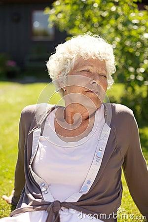 Senior woman enjoying fresh air - Outdoors