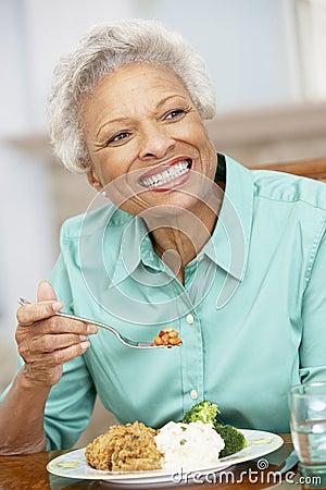 Senior Woman Enjoying A Meal At Home