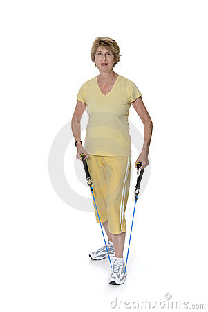 Senior woman exercising with elastic band