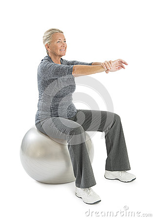 Senior Woman Exercising On Fitness Ball