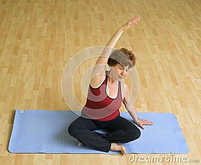 Senior woman exercising yoga