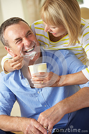 Senior Woman Feeding Husband Ice Cream