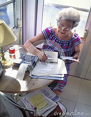 Senior woman with finances