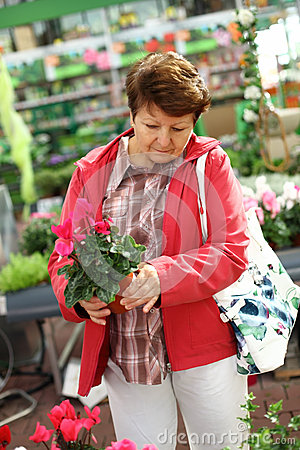 Senior woman in flower shop