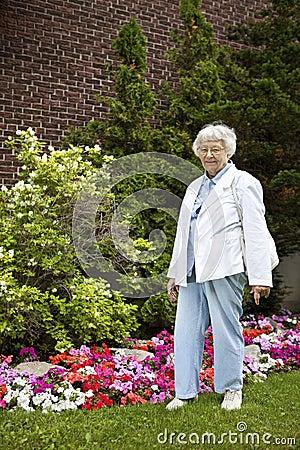 Senior woman with garden background