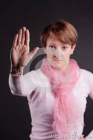 Senior woman gesturing stop
