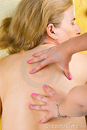 Senior woman getting back massage