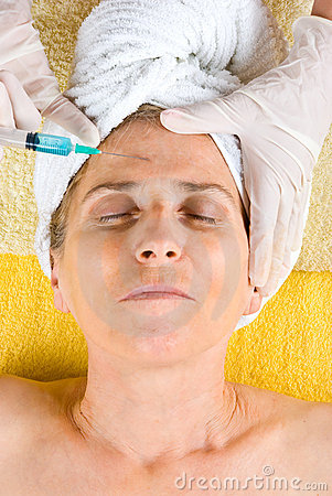 Senior woman getting botox injection