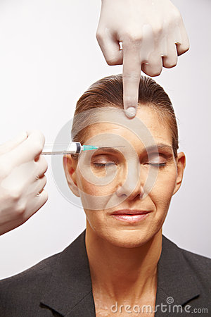 Senior woman getting plastic surgery