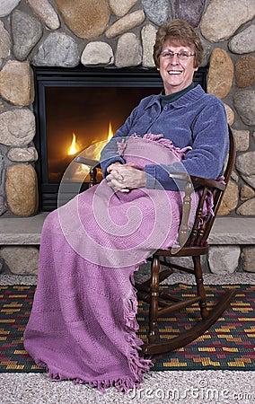 Senior Woman Grandma Rocking Chair Fireplace