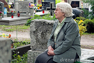 Senior woman in graveyard