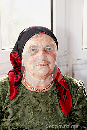 Senior woman in green dress