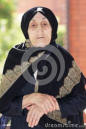 Senior woman hands folded