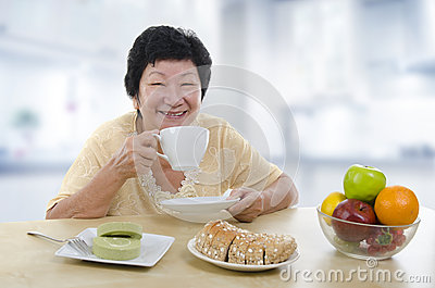 Senior woman having breakfast