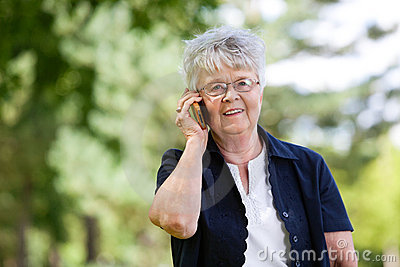Senior woman having conversation on mobile phone