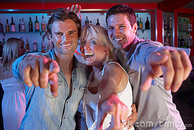 Senior Woman Having Fun In Bar With Two Young Men
