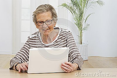 Senior Woman having fun on her computer