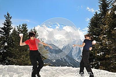 Senior woman having fun in snow winter land