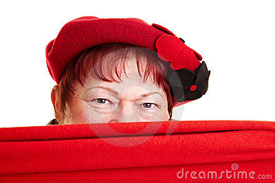 Senior woman hiding behind scarf