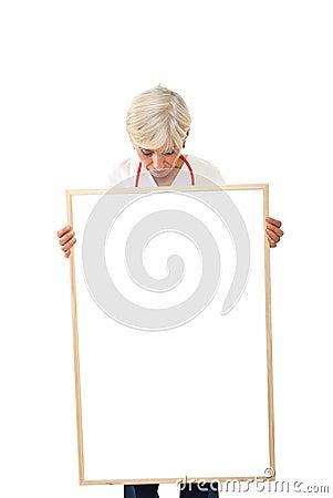Senior woman holding  blank poster