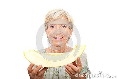 Senior woman holding cantaloupe